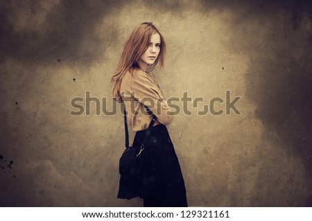 beautiful young girl hipster dreams against the wall