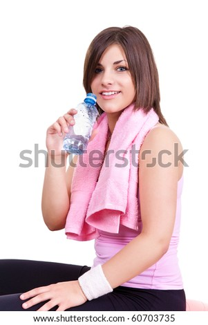 beautiful young girl holding a bottle of water - stock photo