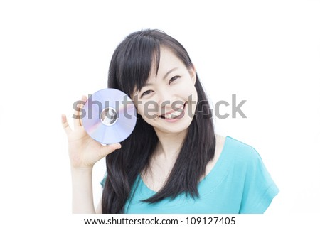 beautiful young girl holding a disc(CD, DVD or Blu-ray) , isolated on white background - stock photo