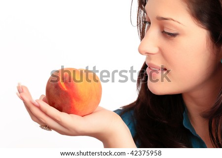 Beautiful young girl holding a peach. - stock photo