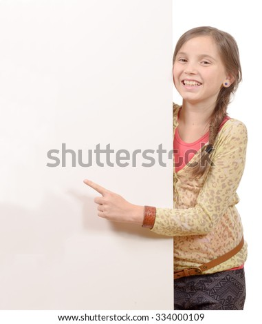 Beautiful young girl holding blank poster isolated on white - stock photo