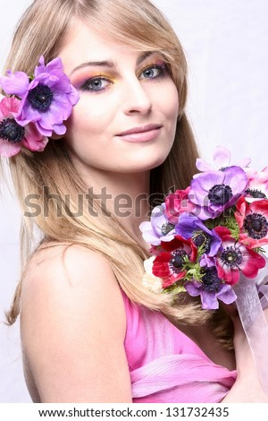 Beautiful young girl holding bouquet of flowers, isolated on white background - stock photo