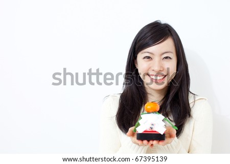 beautiful young girl holding kagami mochi, , traditional Japanese New Year decoration - stock photo