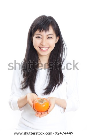 beautiful young girl holding persimmon, isolated on white  background - stock photo