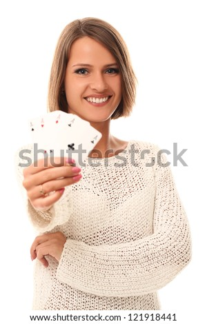 Beautiful young girl holding playing cards in hand - stock photo