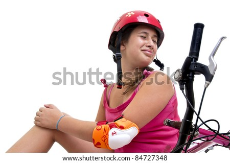 Beautiful young girl in a bicycle crash isolated in white - stock photo