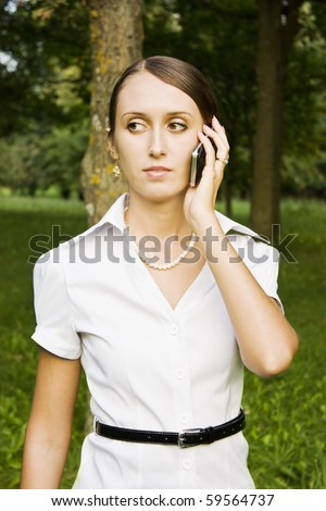 beautiful young girl in a business suit on the phone