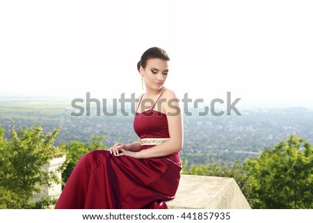 Beautiful young girl in a dress - stock photo