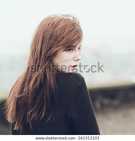 beautiful young girl in a jacket - stock photo