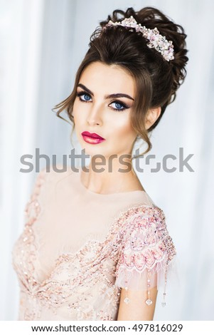 Beautiful young girl in a pink dress