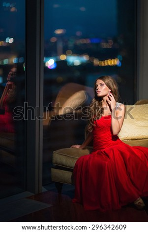 Beautiful young girl in a red dress