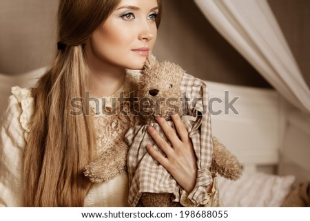 Beautiful young girl in a vintage dress. Gentle pretty woman the classic interior. - stock photo