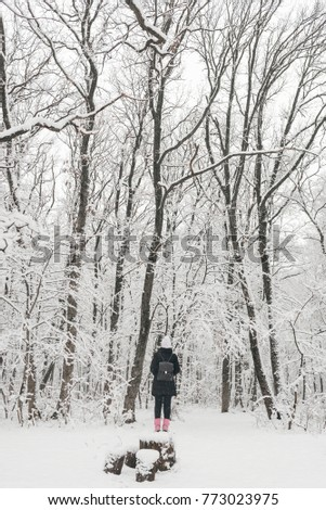 Beautiful young girl in a white fairy winter forest. walk in the fresh air