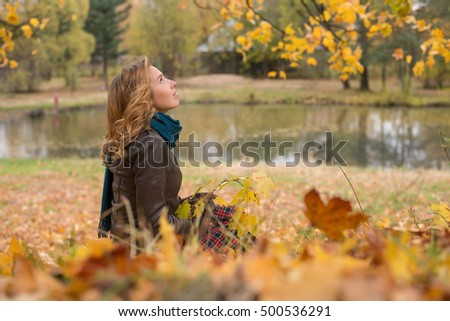 Beautiful young girl in autumn forest