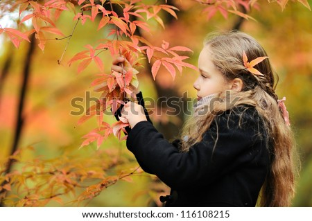 beautiful young girl in autumn park - stock photo
