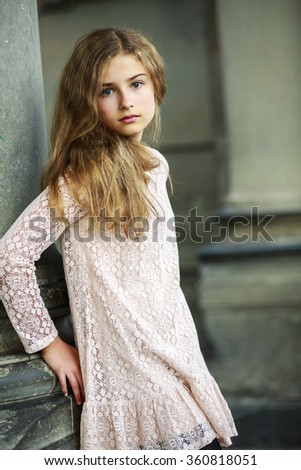 Beautiful young girl in dress posing in Florence, Italy