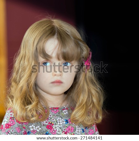 Beautiful young girl in flowered dress - stock photo