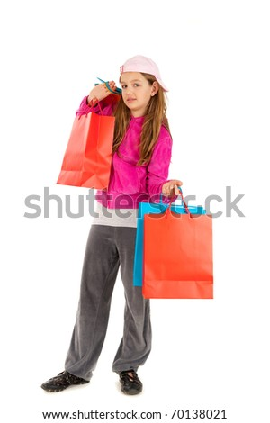 Beautiful young girl in gray and pink tracksuit, with hat and shopping bags isolated on white background