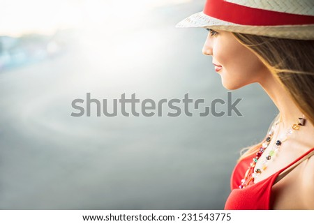 Beautiful young girl in hat - stock photo