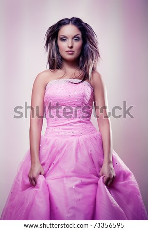 beautiful young girl in pink dress - stock photo