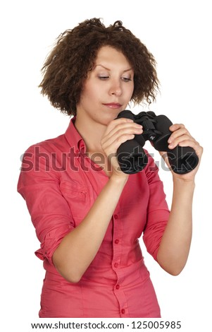 Beautiful young girl in shirt looking through binoculars. Looking in different directions. looking through binoculars