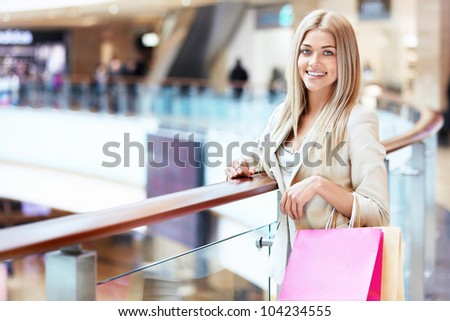 Beautiful young girl in store - stock photo