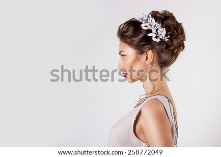 beautiful young girl in the image of the bride, beautiful wedding hairstyle with flowers in her hair, hairstyle for bride - stock photo