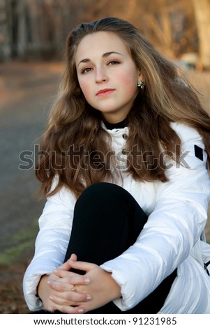 Beautiful young girl in the park - stock photo