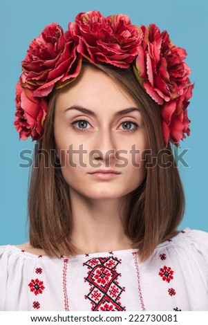 Beautiful young girl in the Ukrainian national suit isolated  - stock photo