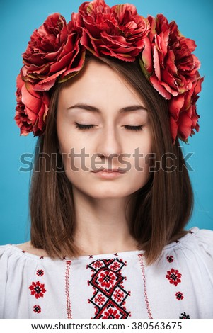 Beautiful young girl in the Ukrainian national suit with closed eyes