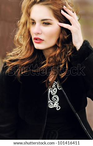 beautiful young girl in windy weather - stock photo