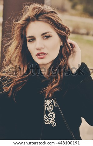 beautiful young girl in windy weather day - stock photo