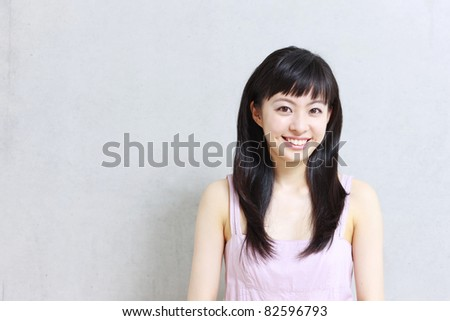 beautiful young girl introducing something - stock photo
