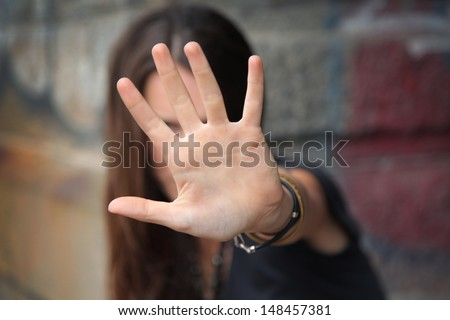 beautiful young girl is hiding - stock photo