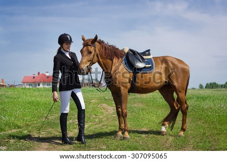 Beautiful young girl jockey with her horse dressing uniform competition - stock photo