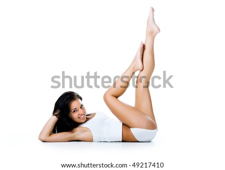 Beautiful young girl lie. Isolated on a white background