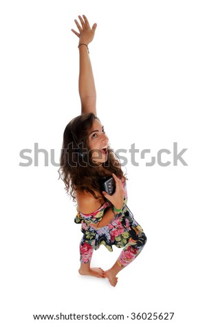 Beautiful young girl listening to music and dancing - stock photo