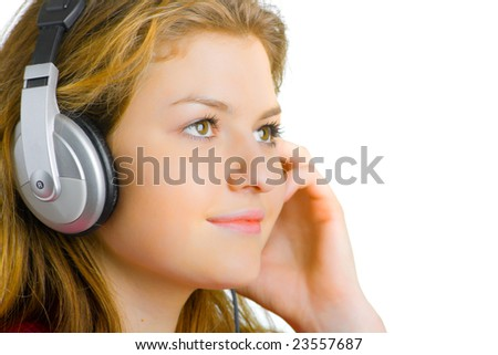 beautiful young girl listens to music with headphones
