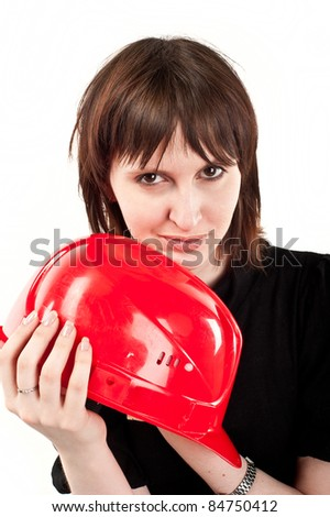 beautiful young girl looks into the camera in the construction helmet, isolated over white