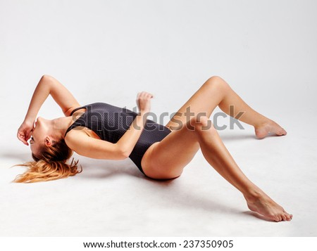 beautiful young girl lying on the floor - stock photo