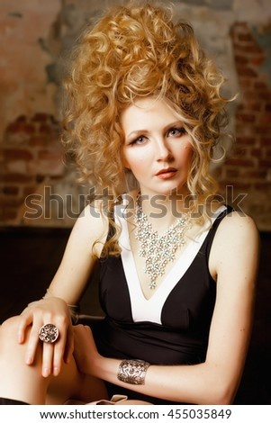 Beautiful young girl model blonde hair fluffy hairstyle makeover