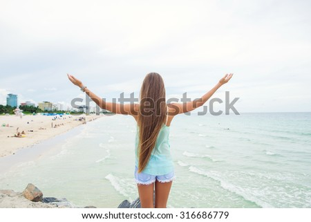 beautiful young girl model with long hair enjoy beach view - stock photo