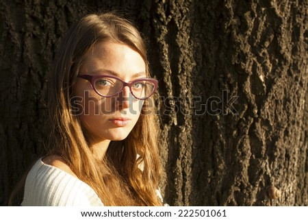 Beautiful Young Girl Next To A Tree Outdoor