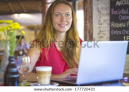 Beautiful young girl on a cafe.  - stock photo