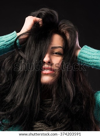 Beautiful young girl on a dark background - stock photo