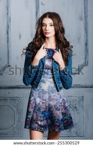 Beautiful young girl on a gray background - stock photo