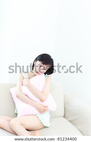 Beautiful young girl on a sofa - stock photo