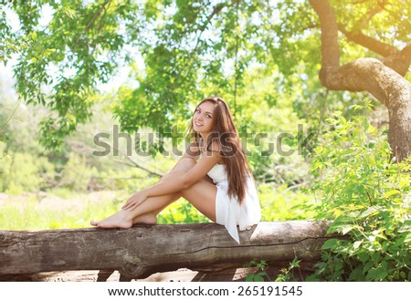 Beautiful young girl on the nature in sunny summer day - stock photo