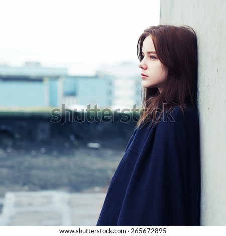beautiful young girl on the roof in the spring - stock photo