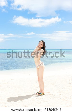 beautiful young girl on tropical island beach